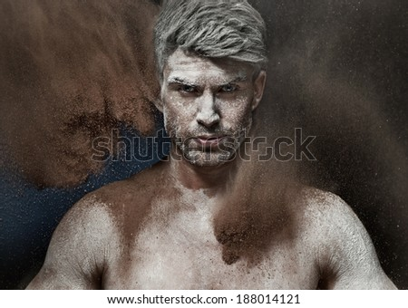 Portrait of a man in a dust - stock photo