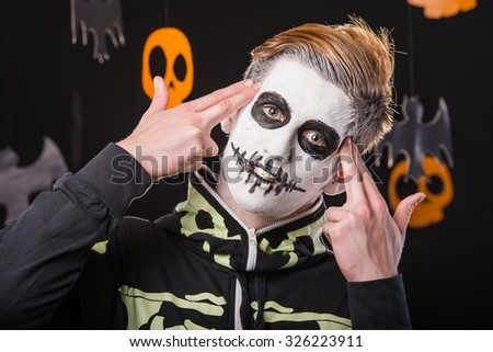 Portrait of a man in a Halloween costume. Skeleton. Studio portrait on black background