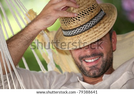 portrait of a man in a hammock