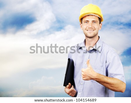 portrait of a man in a helmet on the sky - stock photo