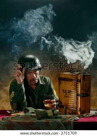 Portrait of a man in a military style - stock photo