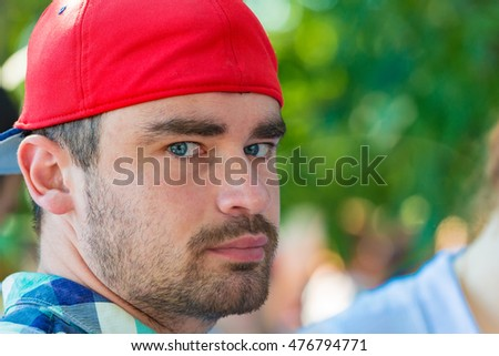 Portrait of a man in a red baseball cap