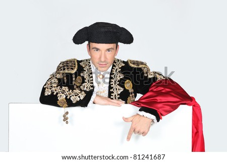 portrait of a man in bullfighter costume - stock photo