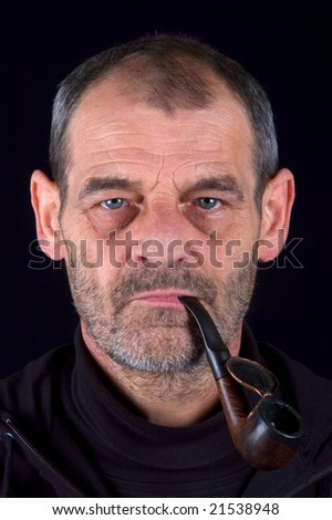 Portrait of a man in his fifties with pipe - stock photo