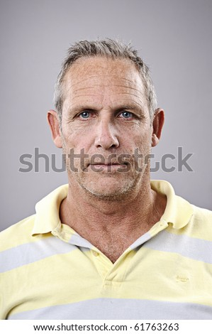 Portrait of a man in studio with grey background - stock photo