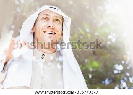portrait of a man in traditional arabic muslim headwear - stock photo
