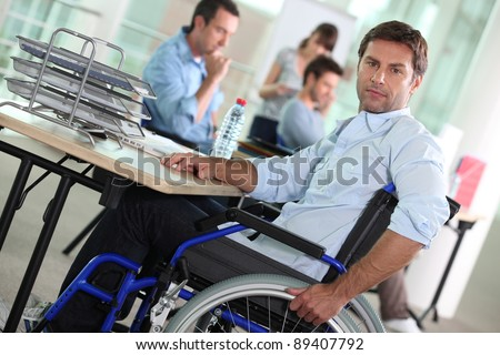 portrait of a man in wheelchair - stock photo