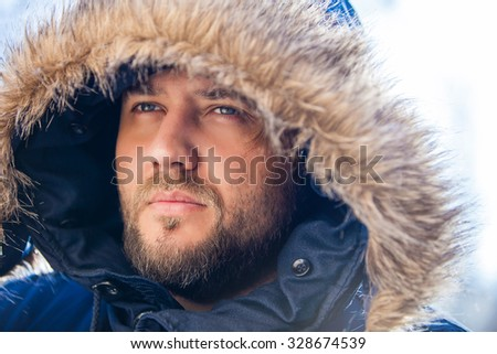 Portrait of a man in winter clothes - stock photo