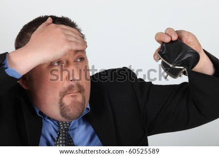 Portrait of a man indebted - stock photo