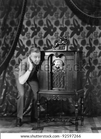 Portrait of a man listening to music from a radio and smiling - stock photo