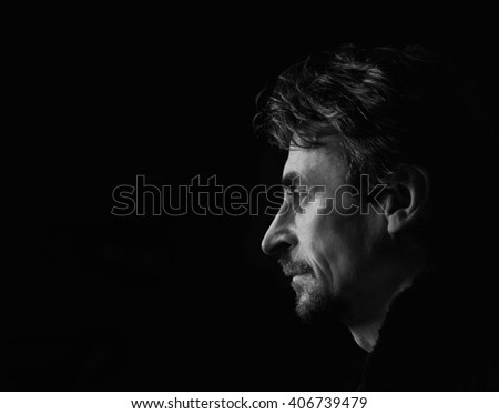 Portrait of a man.Low key,black and white. - stock photo