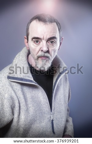 Portrait of a man made-up as devil - stock photo