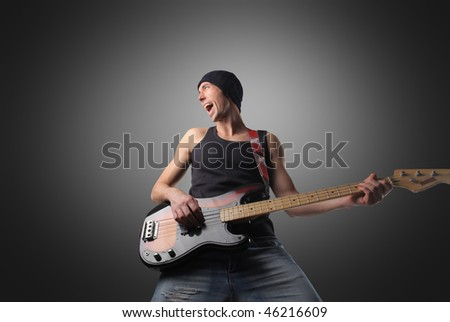 Portrait of a man playing a bass guitar