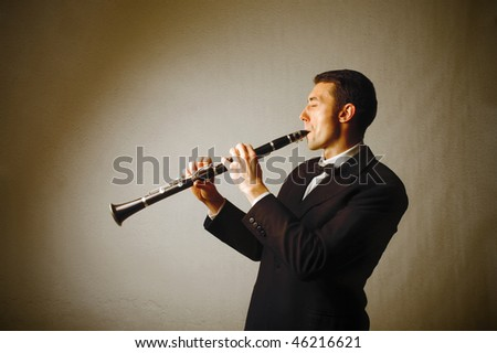 Portrait of a man playing the clarinet