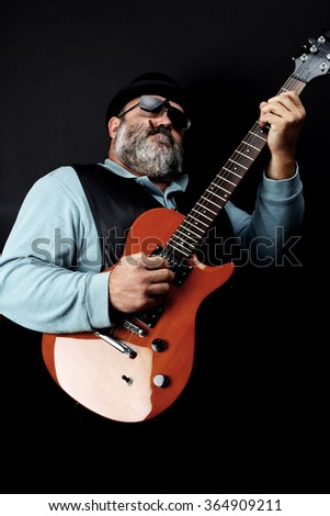 portrait of a man playing the electric guitar