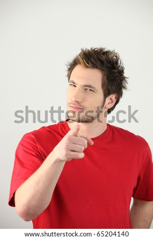 Portrait of a man pointing with his finger - stock photo