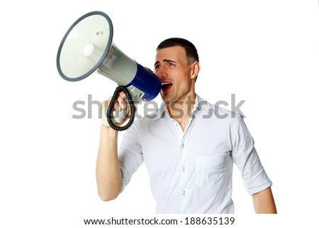 Portrait of a man roaring loudly into megaphone over white background - stock photo