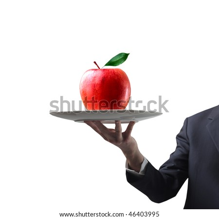 Portrait of a man's hand carrying a red apple on a dish - stock photo