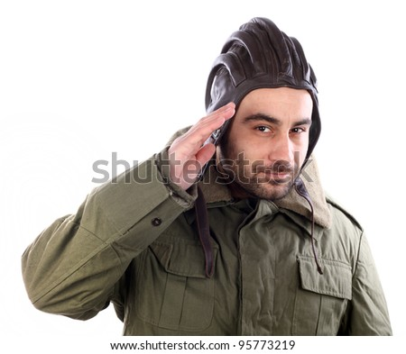Portrait of a man saluting with a leather helmet over white