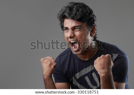 Portrait of a man screaming with high energy - stock photo