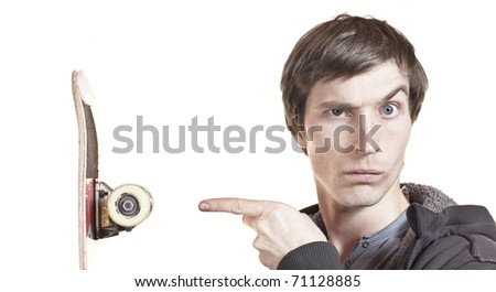 portrait of a man showing his skateboard isolated on white - stock photo