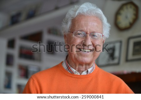 Portrait of a man smiling in his house - stock photo