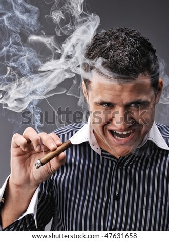 Portrait of a man smoking cigar - stock photo
