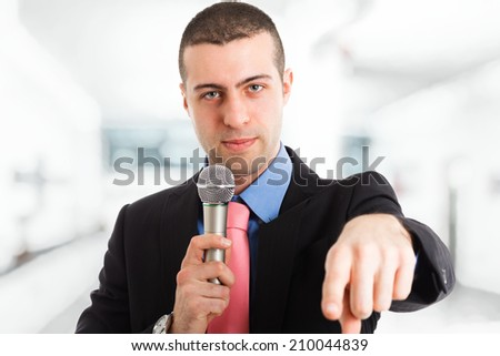 Portrait of a man speaking in a microphone - stock photo