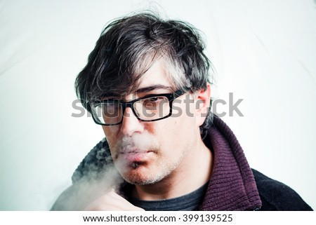 Portrait of a man vaping.