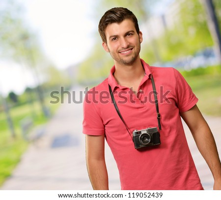 Portrait of a man wearing camera, outdoor