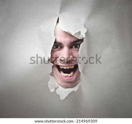 portrait of a man who goes out from a paper sheet - stock photo