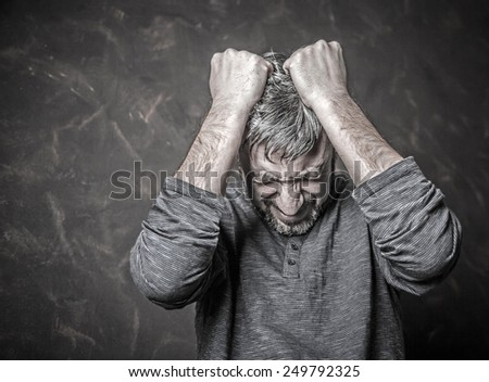 portrait of a man who shouts from the experiences - stock photo