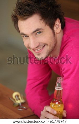 Portrait of a man with a beer in hand - stock photo