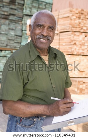 Portrait of a man with a clipboard in warehouse