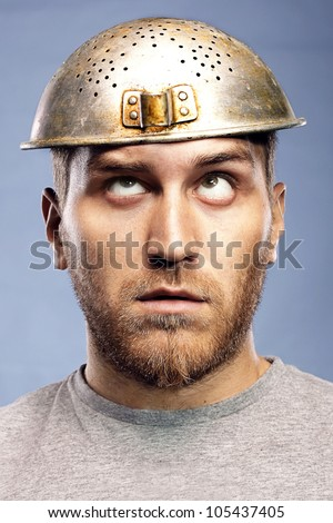 portrait of a man with a colander on his head - stock photo
