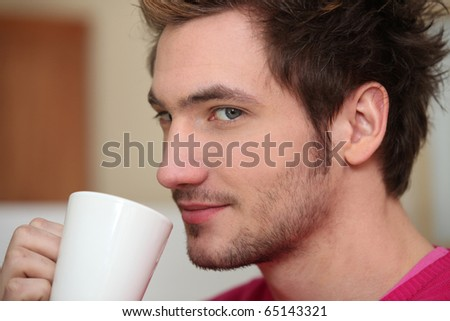 Portrait of a man with a cup of coffee - stock photo
