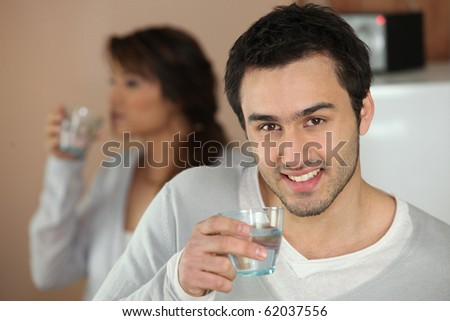 Portrait of a man with a glass of water