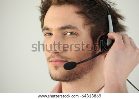 Portrait of a man with a headset - stock photo