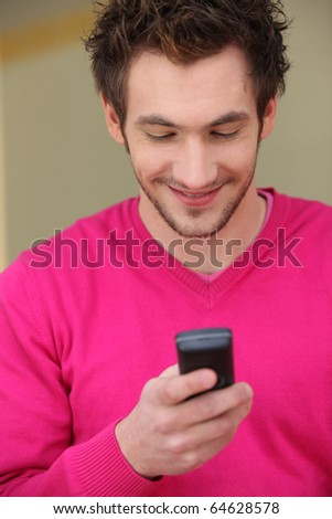 Portrait of a man with a mobile phone - stock photo