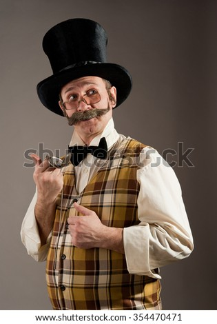 Portrait of a man with a mustache wearing a hat in a retro style with a clock. - stock photo
