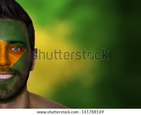Portrait of a man with a painted flag of Brazil - Latin America - stock photo