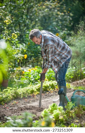 Portrait of a man with a spade doing gardening