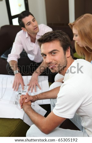 Portrait of a man with a woman and a realtor - stock photo