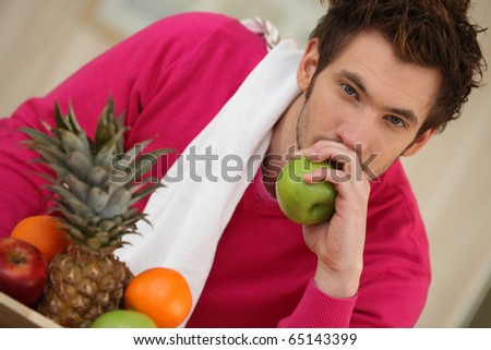 Portrait of a man with an apple - stock photo