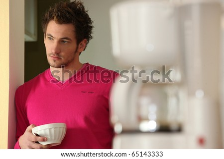 Portrait of a man with bowl in hand - stock photo