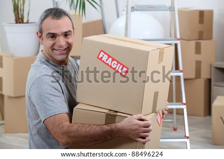 portrait of a man with cardoard boxes - stock photo
