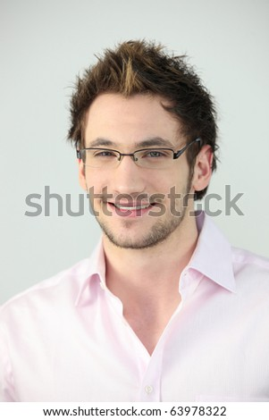 Portrait of a man with eyeglasses - stock photo