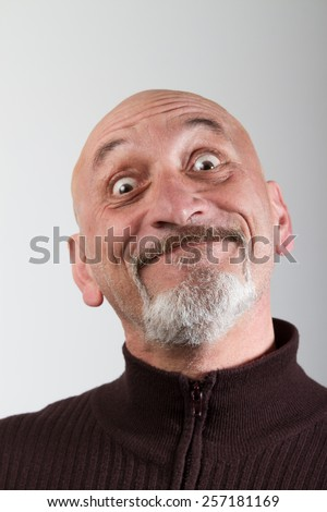 Portrait of a man with facial expression very funny - stock photo