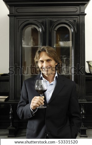 Portrait of a man with glass of red wine - stock photo