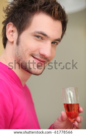 Portrait of a Man with glass of rose wine - stock photo